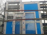 Двухстворчатое окно EuroLine со шпроссами