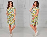 Платье с ярким летним принтом, с поясом на талии и карманами по бокам.