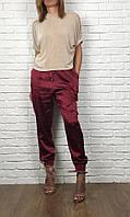 Трендовые брюки в стиле urban chic из мерцающей ткани  PN2442