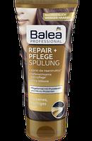 Профессиональный бальзам-ополаскиватель для поврежденных волос Balea Professional Repair Spülung
