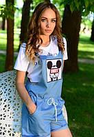 Женский джинсовый комбинезон с караманами