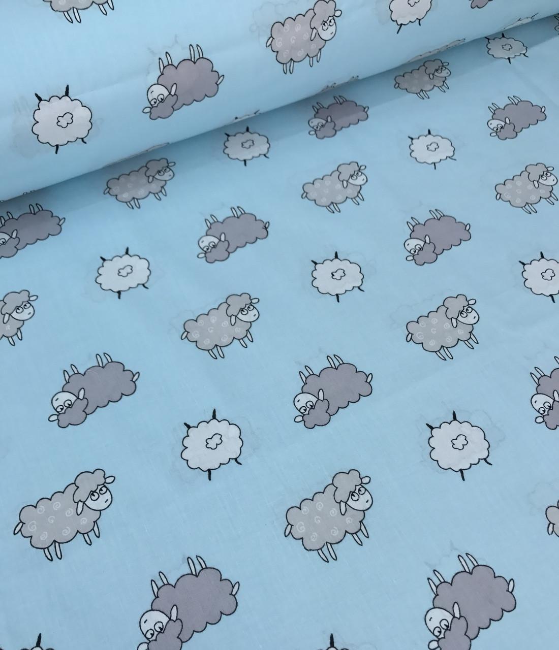Хлопковая ткань ЛЮКС польская овечки серо-белые на голубом