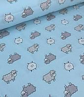 Хлопковая ткань польская овечки серо-белые на голубом