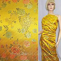Атласная ткань шелк восточная желтая в разноцветные цветы атлас