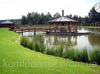 Беседка с барбекю на озере с мостиком