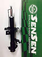 Амортизатор передний левый Nissan Tiida/LIVINA GENISS/GRAND LIVINA 2006-