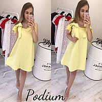 Желтое платье с бантами