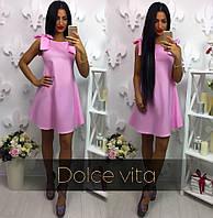 Элегантное женское платье розового цвета