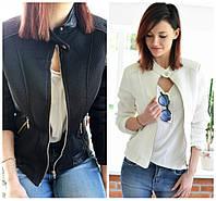 Женская белая и черная куртка