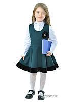 Шкільний сарафан зеленого кольору.