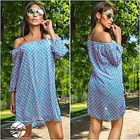 Элегантное летнее платье свободного силуэта с фиксирующей резинкой на плечах и рукавах, декорировано принтом.