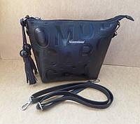 Модная женская маленькая сумка-косметичка черная с кисточками