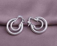 Серебряные стильные оригинальные изумительные серьги пересек круг