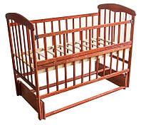 Кроватка деревянная детская маятник - откидной бортик Наталка ясень темный