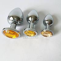 Анальная втулка с желтым кристаллом+ чехол 2.8*7.5 см.