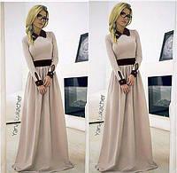 Элегантное длинное платье в пол с отделкой на воротнике, поясе и манжетах