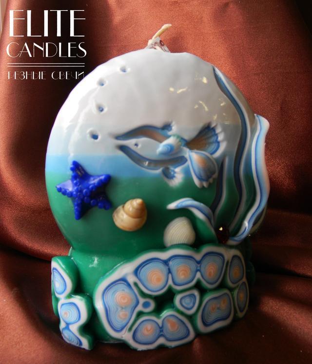 Свеча морская формы камня. Сине-голубой цвет.