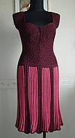 Вязаное платье с косами