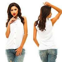 Женская белая блуза-рубашка без рукавов.
