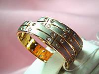 Кольцо обручальное 585 пробы из белого и розового золота с фианитами