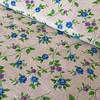 Лён с голубыми и фиолетовыми цветами на бежевом фоне, ширина 150 см