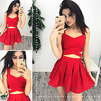 Летний женский комплект из юбки и топа с переплетами в красном цвете