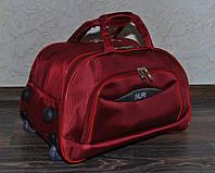 Маленькая дорожная сумка на колесах Nuri 7882 красная