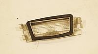 Стекло фонаря подсветки номера б/у Renault Megane 2 7700428051