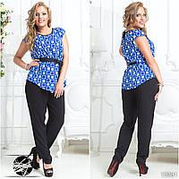 Стильный комплект: кофта и штаны. Блуза свободного силуэта. Штаны на резинке с карманами по бокам.