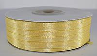 Лента атласная. Цвет - бледно-желтый. Ширина - 0,3 см, длина - 123 м
