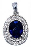 Кулон женский. Камень: синий и белый циркон. Цвет металла: серебряный. Высота: 2,8 см. Ширина: 16 мм.
