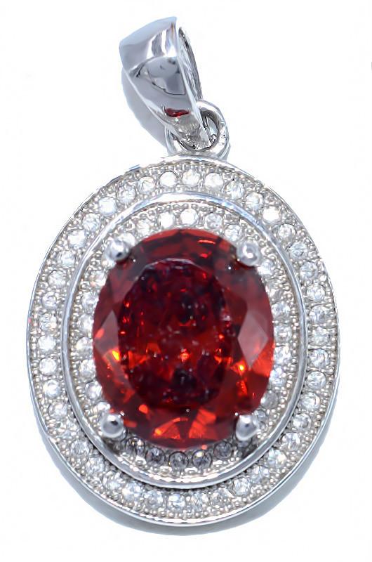 Кулон женский. Камень: красный и белый циркон. Цвет металла: серебряный. Высота: 2,8 см. Ширина: 16 мм.