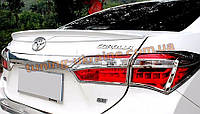 Спойлер на крышку багажника из ABS пластика на Toyota Corolla 2013