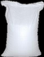 Соль каменная затаренная в мешки по 50 кг помол 3