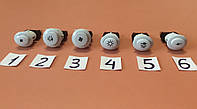 Кнопки для включения разных режимов в газовых плитах / белые
