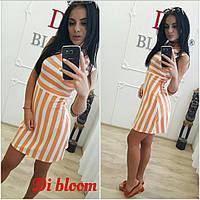 Оригинальное оранжевое платье в полоску