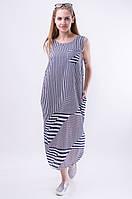 Женское платье свободного кроя длины миди