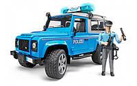 Джип Bruder Land Rover Defender Полиция с фигуркой полицейского М1:16 Синий (02597)