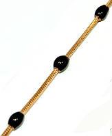 Браслет с чёрными вставками, цвет - позолота. Длинна 20 см.Ширина 3 мм.