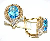 Серьги ХР позолота+родий,камень: белый и голубой циркон; высота серьги 1,5 см. ширина 12 мм.