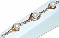 Серебряный женский браслет с золотыми вставками. Камни: циркон и жемчуг. Длинна регулируется.