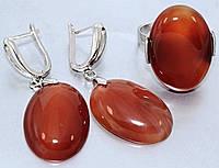 Набор: серьги с кольцом. Покрытие родием. Камень: сердолик. Высота серьги 4,5 см. Диаметр камня 19 мм.