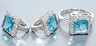 """Набор  """"серьги и кольцо"""",покрытие родием. Камень:белый и голубой циркон. Высота серьги: 1,5 см Ширина: 10 мм"""