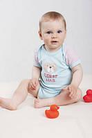 Одежда для новорожденных: комплект-минимум для первых недель