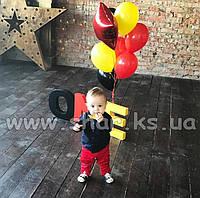 Фонтан из красных, желтых и черных шаров со звездой