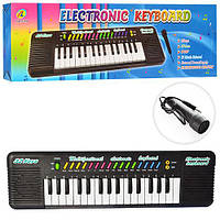 Синтезатор 3218 (48шт) 32 клавиши, микрофон,рег.громк,3тона,3ритма,на бат-ке,в кор-ке,49,5-14-3,5см