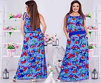Легкое женское платье с карманами по бокам, на бретелях и в цветочный принт.