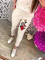 Женские белые брюки с вышивкой и дырками тренд 2017 года