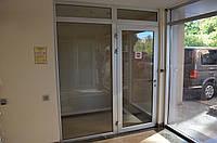 Алюминиевые маятниковые двери, фото 1