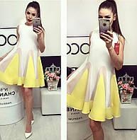 Женское платье с оригинальными воланами